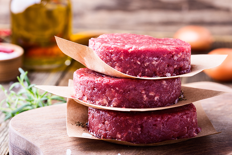 Raw ground beef, round patties for making burgers